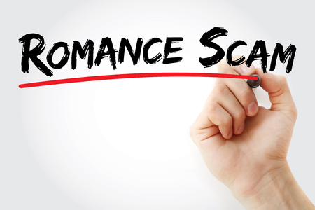 Hand writing romance scam with marker, concept background
