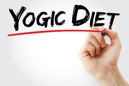 Hand writing yogic diet with marker, concept background Stock Photo