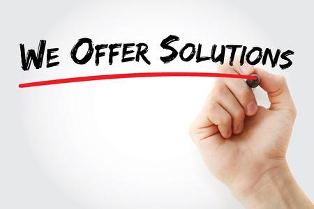 Hand schrijven bieden wij oplossingen met marker, business concept achtergrond Stockfoto