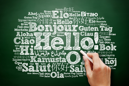 multilingual: Hello word cloud in different languages of the world, education business concept on blackboard Stock Photo