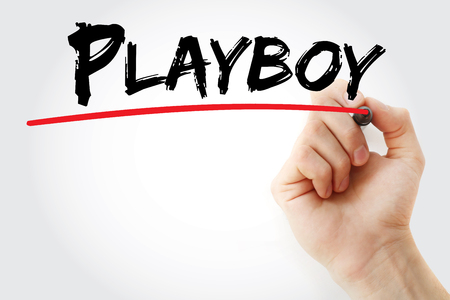 Hand writing Playboy with marker, concept background Stock Photo