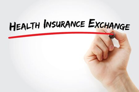 Hand writing Health Insurance Exchange with marker, concept background