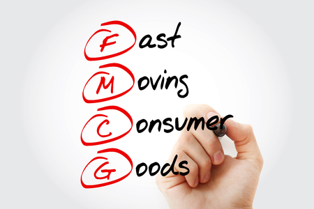 Hand writing FMCG - Fast Moving Consumer Goods acronym with marker, concept background 版權商用圖片