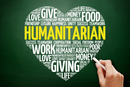 Humanitarian heart word cloud collage, concept on blackboard