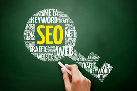SEO - Search Engine Optimization key word cloud collage, business concept on blackboard Stock Photo