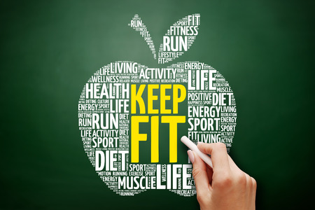 KEEP FIT apple word cloud collage, health concept on blackboard Stock Photo