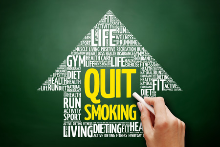 Quit Smoking arrow word cloud collage, health concept on blackboard Stock Photo