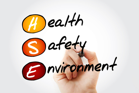 Hand writing HSE - Health Safety Environment acronym with marker, concept background Standard-Bild