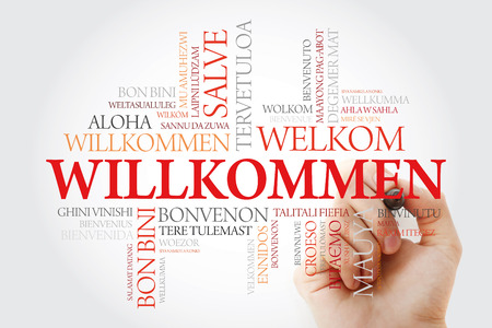 Willkommen, Welcome in German. Word cloud with marker in different languages, conceptual background