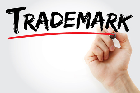 Hand writing Trademark with marker, concept background