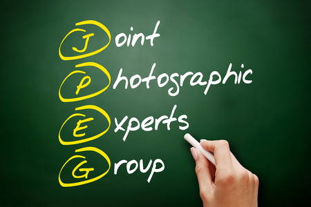 JPEG - Joint Photographic Experts Group acronym, concept on blackboard Фото со стока