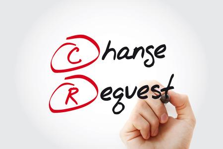 Main qui écrit CR - Demande de changement avec marqueur, concept d'entreprise acronyme Banque d'images