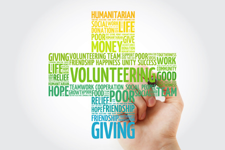 Volunteering word cloud with marker, cross concept background Stock Photo