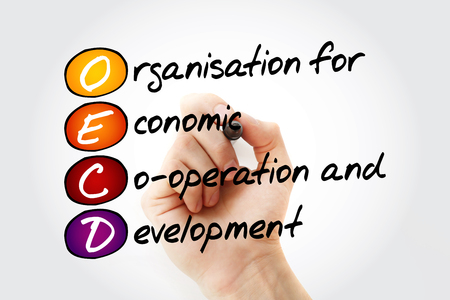 OECD - Organisation for Economic Co-operation and Development acronym with marker, business concept background Foto de archivo