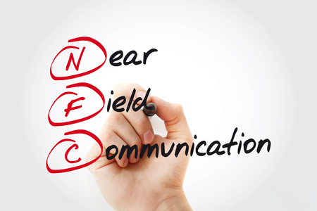 Hand writing NFC Near Field Communication with marker, acronym concept