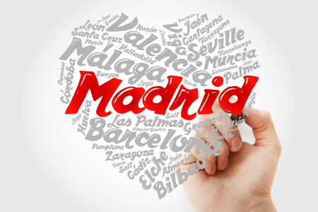 List of cities and towns in Spain composed in love sign heart shape, word cloud collage with marker, business and travel concept background Imagens