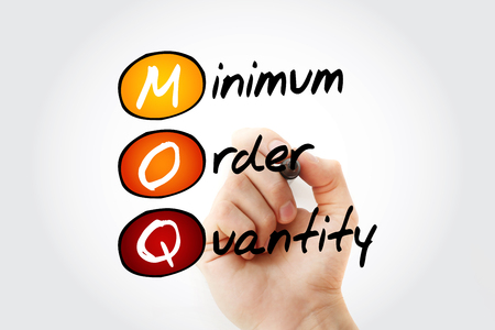 MOQ - Minimum Order Quantity acronym with marker, business concept background