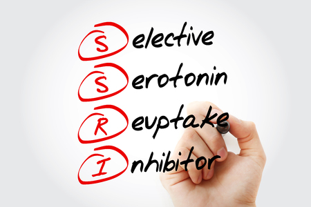 SSRI - Selective Serotonin Reuptake Inhibitor acronym with marker, concept background