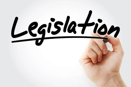 Legislation text with marker, business concept