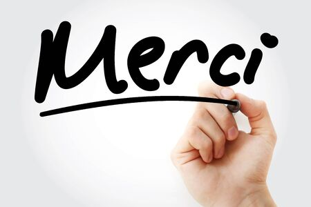 Merci text means Thank You In French with marker, concept background Foto de archivo