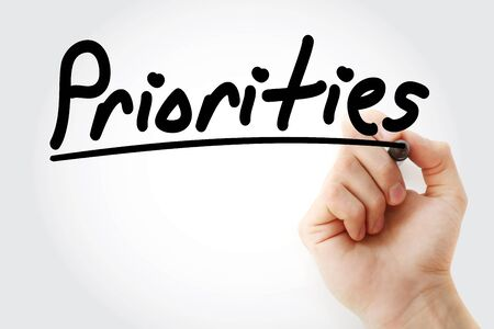 Priorities text with marker, business concept background Stock Photo