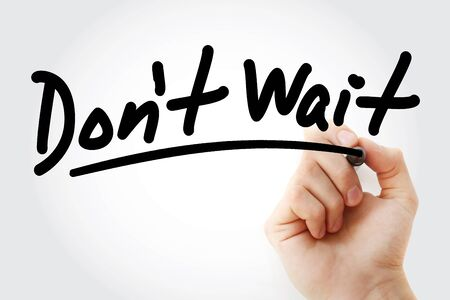 Dont Wait text with marker, business concept background Stock Photo