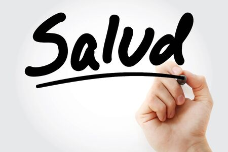 Salud means Health in Spanish text with marker, health concept background Stock Photo