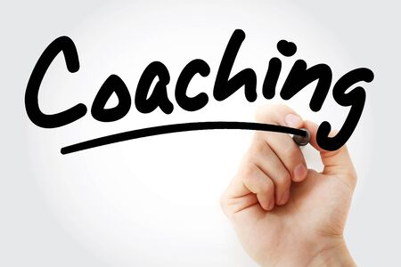 Coaching text with marker, business concept