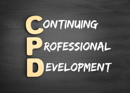 Wooden alphabets building the word CPD - Continuing Professional Development acronym on blackboard