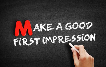 Make a Good First Impression text on blackboard, business concept background
