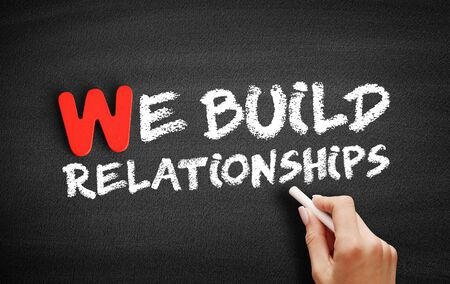 We Build Relationships text on blackboard, concept background