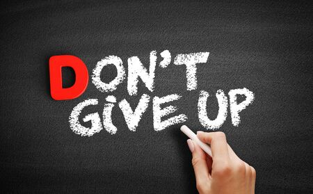Don't Give Up text on blackboard, business concept background Imagens