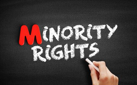 Minority rights text on blackboard, business concept background