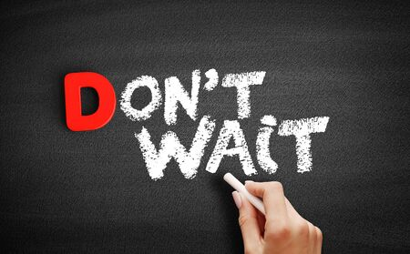 Dont Wait text on blackboard, business concept background