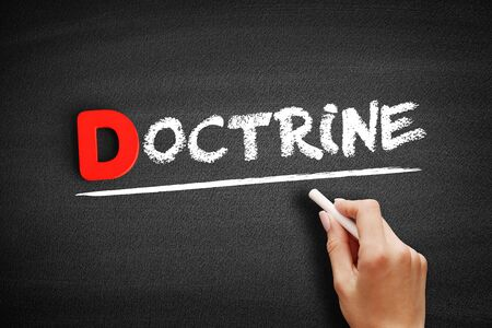 Doctrine text on blackboard, business concept background
