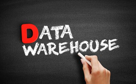 Data warehouse text on blackboard, business concept background