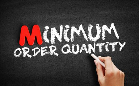 Minimum Order Quantity text on blackboard, business concept background