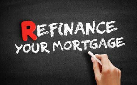 Refinance Your Mortgage text on blackboard, business concept background
