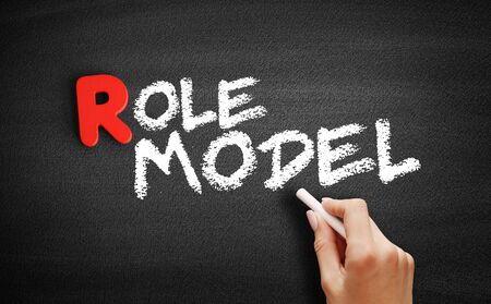 Role model text on blackboard, business concept background