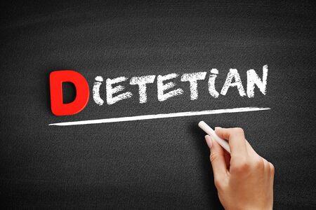 Dietetian text on blackboard, business concept background