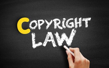 Copyright law text on blackboard, business concept background 版權商用圖片