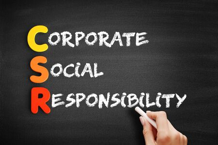 CSR - Corporate Social Responsibility text on blackboard, business concept background