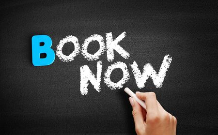 Book Now text on blackboard, business concept background