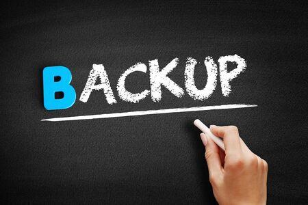 Backup text on blackboard, business concept background Banco de Imagens
