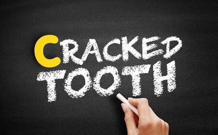 Cracked tooth text on blackboard, concept background