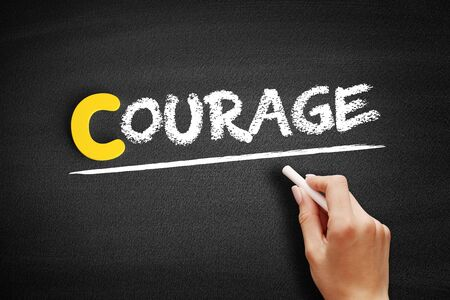 Courage text on blackboard, business concept background