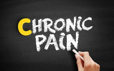 Chronic pain text on blackboard, concept background Stock fotó