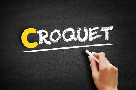 Croquet text on blackboard, concept background