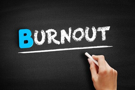 Burnout text on blackboard, business concept background