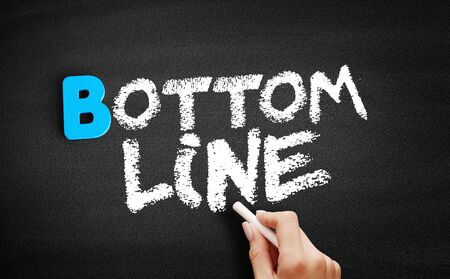 Bottom line text on blackboard, concept background Stock Photo